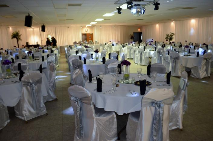 Our beautiful banquet hall housed a gorgeous silver & white wedding reception.]